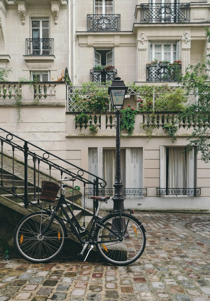 A bicycle against a railing