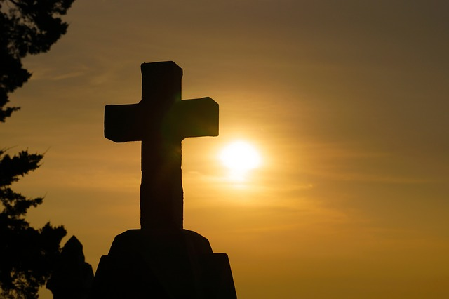 A cross against the sun