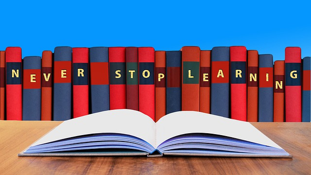 "illustration of books, text ""never stop learning"""