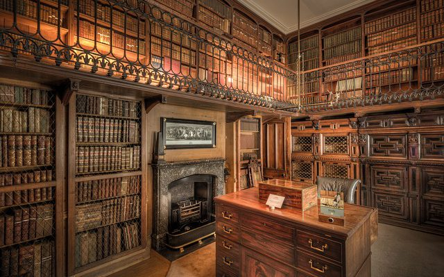 a writing desk in a personal library