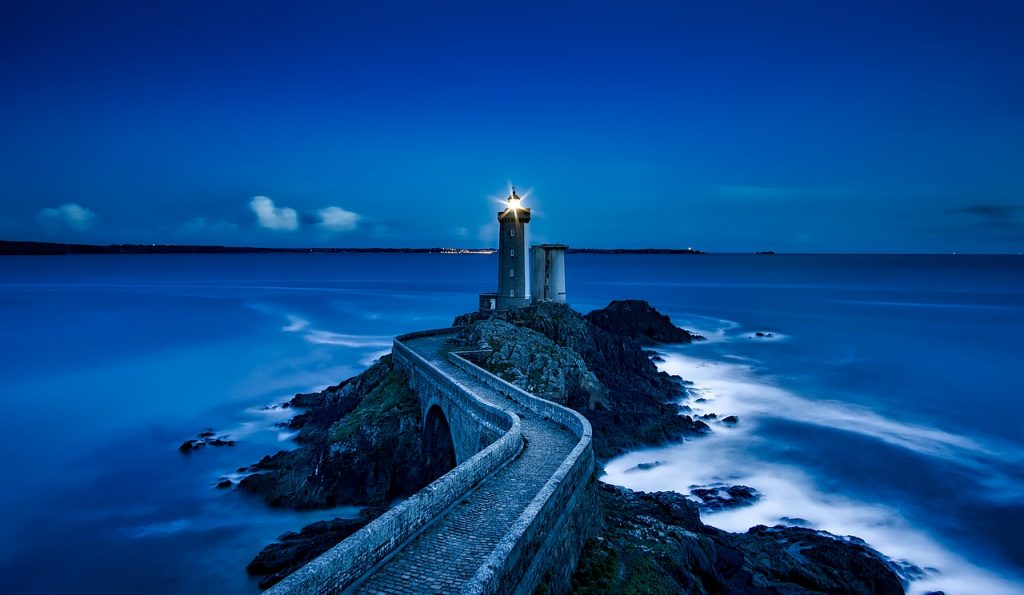 a lighthouse at the water's edge