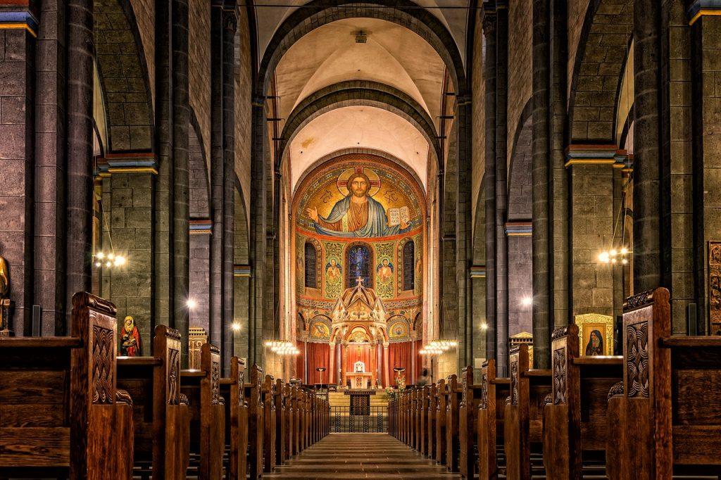 mosaics at the end of a long church