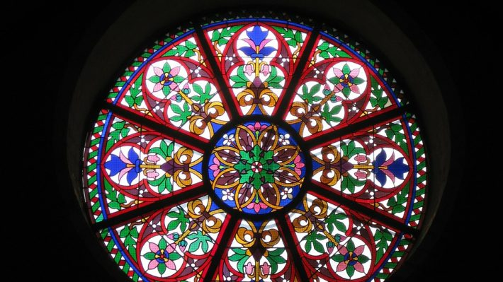 a rose shaped stained glass window