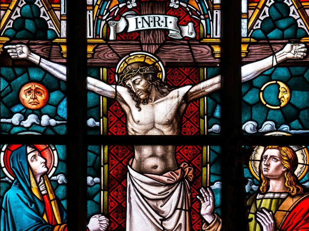 A stained glass window of Jesus on the cross