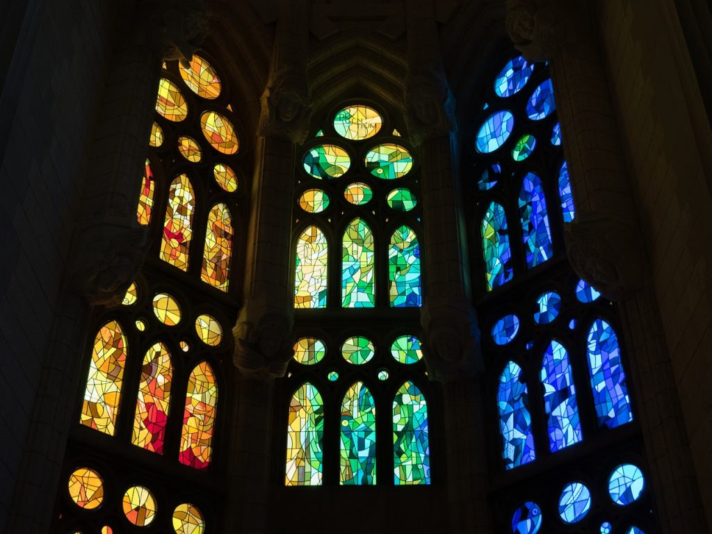 A wall of stained glass in a gothic church